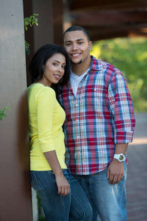 engaged: Young Hispanic Couple Engagement Picture Outdoor Portrait Stock Photo