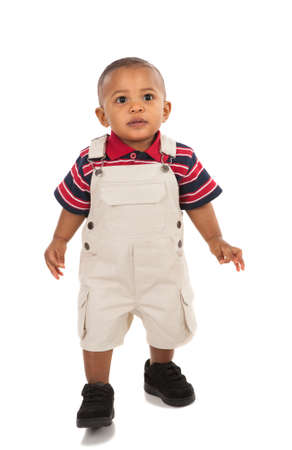 infants: 1-year old african american boy standing with curious expression looking at camera Stock Photo