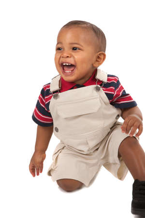 1-year old African American baby boy Sit on Floor Laughing portrait on isolated white photo