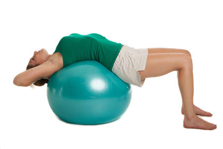 Young Slim Girl Exercise with Fitness Ball on Isolated Background photo
