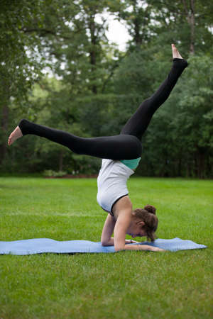 tree position: Female Yoga Practice  at Outdoor Park Flexible Pose