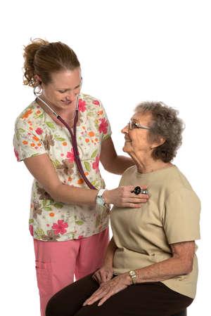 work checkup: Friendly Nurse Check Elderly Senior Isolated on White Background
