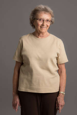 80 year old: 80 Year Old Elderly Senior Happy Portrait Standing on Gray Background Stock Photo