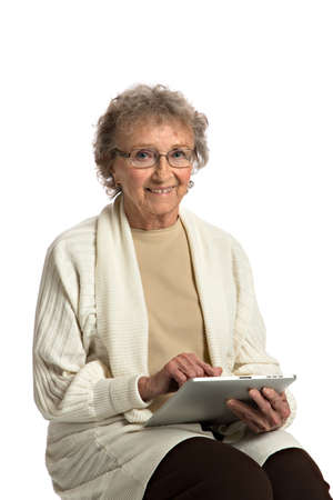 80 year old: 80 Year Old Elderly Senior Texting on Tablet Computer Isolated on White Background