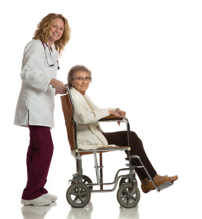 Home Care Nurse Push Senior on Wheelchair on Isolated White Background photo