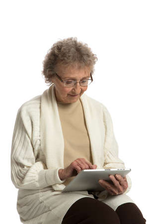 80: 80 Year Old Elderly Senior Texting on Tablet Computer Isolated on White Background
