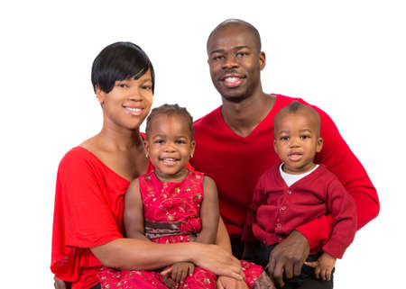 Portrait of Happy Smiling African American Family Wearing Holiday Outfits Isolated on White Background photo