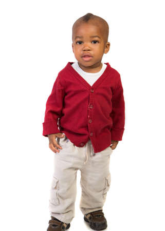 1 year old baby boy standing wearing holiday red sweaterl on isolated on white background photo