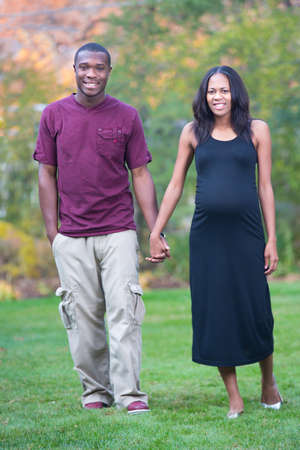 Black Couple Expecting Pregnancy Woman Walking Outdoor photo