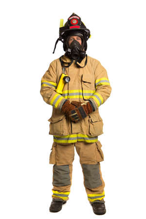 Firefighter with mask and fully protective suit on isolated white background photo
