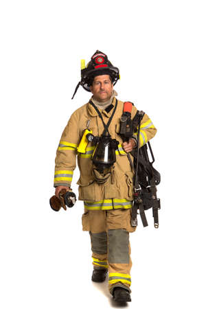 fireman helmet: Firefighter holding mask and airpack fully protective suit walking on isolated white background