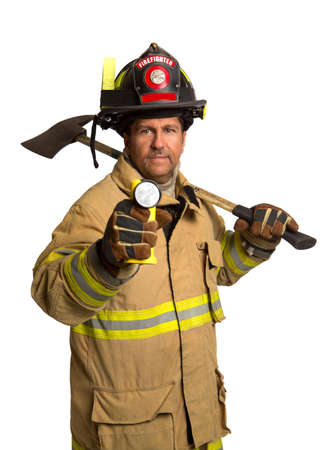 Serious looking confident firefighter standing holding ax and flash light portrait isolated on white photo