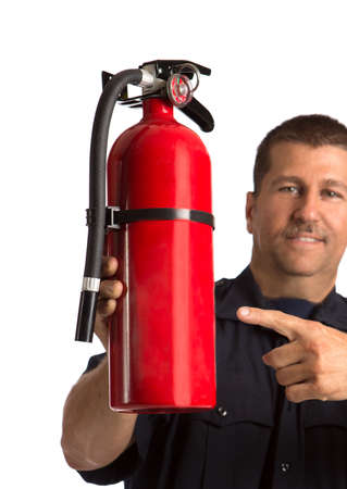 Firefighter paramedic in uniform holding fire extinguisher closeup on isolated white background photo