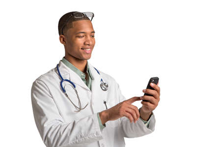African American Doctor HoldingSmart Phone Texting on Isolated White Background