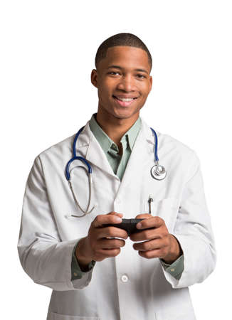 African American Doctor HoldingSmart Phone Texting on Isolated White Background photo