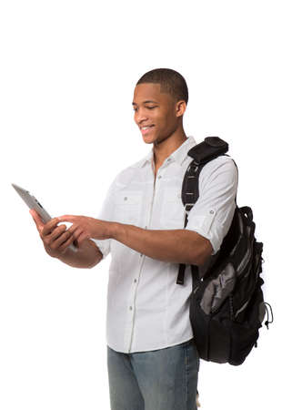Happy African American College Student Holding Tablet PC on Isolated White Background Stock Photo
