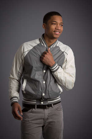 Casual Dressed Young African American Male Model Natural Looking on Grey Background Stock Photo - 21498978