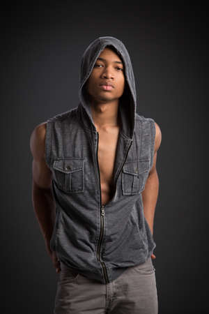 Casual Dressed Young African American Fashion Male Model Natural Looking on Grey Background Stock Photo - 21499056