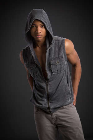 Casual Dressed Young African American Fashion Male Model Natural Looking on Grey Background photo