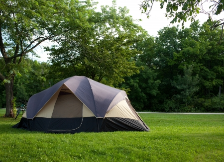camping tent: Camping Tent at Campground during Daytime in Woods Stock Photo