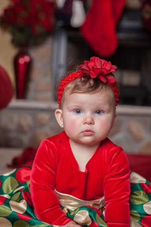 Adorable Cute Infant Baby in Christmas Costume in front of fireplace Stock Photo - 21499236