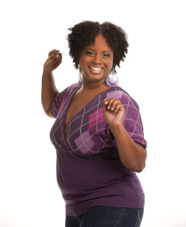large size: Cheerful Young African American Woman Confident Expression on White Background Isolated Stock Photo