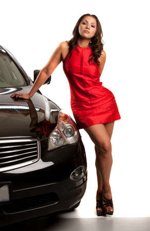 sexy woman car: Sexy Looking Young Asian Female Standing by the Car Isolated Stock Photo