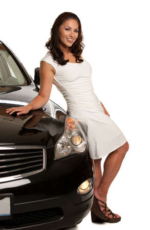 Joyful Asian Female Driver Standing by the Car on White photo
