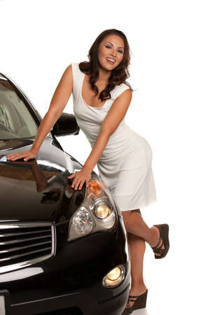 out door: Sexy Asian Female Driver Standing by the Car on White
