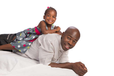 Happy African American Father with Baby Girl on Back white background photo