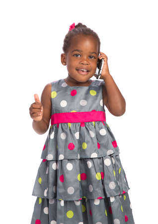 Three Years Old Adorable African American Girl Talking on Cellphone White Background photo