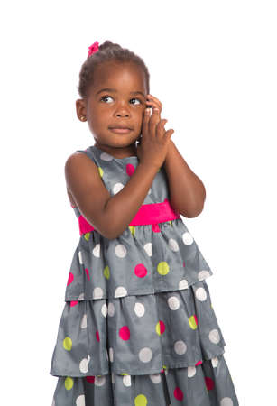 Three Years Old Adorable African American Girl Talking on Cellphone Isolated White Background photo