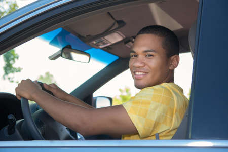 african american male: Young Smiling African American Male in Driver Seat Car