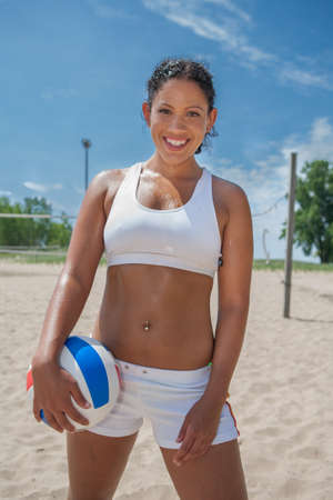 Natural Looking Happy Healthy African American Beach Volleyball Player photo