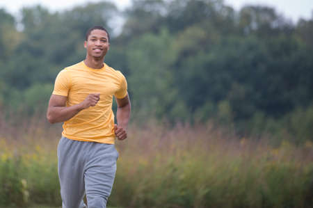 Young Healthy African American Jogging Outdoor Under Morning Sunlight photo