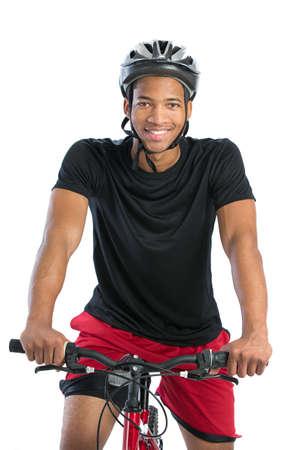 ciclista: Alegre joven americana masculina Riding Bike africana aislada sobre fondo blanco Foto de archivo