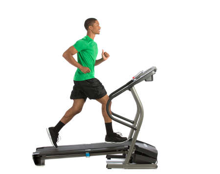 machines: Healthy Young African American Running in Treadmill Isolated on White Background Stock Photo