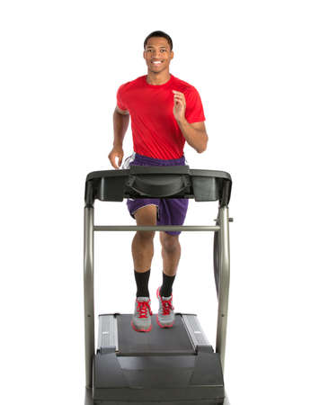 Healthy Young African American Running in Treadmill Isolated on White Background Stock Photo - 22221474