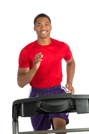 Healthy Young African American Running in Treadmill Isolated on White Background Stock Photo - 22221475