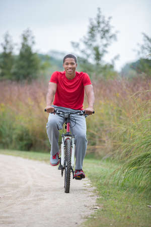 Smiling Healthy Looking Young African American Biking Outdoor Stock Photo - 22221480