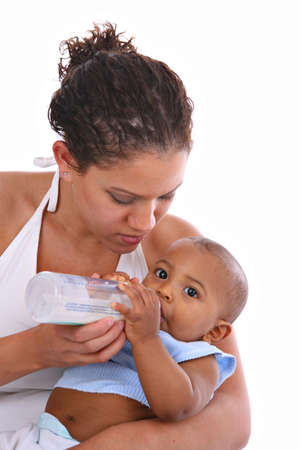 Young African American Mother Feeding Baby Boy with Milk Bottle photo