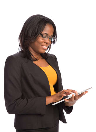Laughing Young African American Female Businessman Holding a Touch Pad Tablet PC on Isolated White Background photo