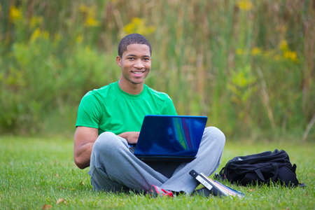 laptop outside: Happy African American College Student Holding Laptop Studying outdoor
