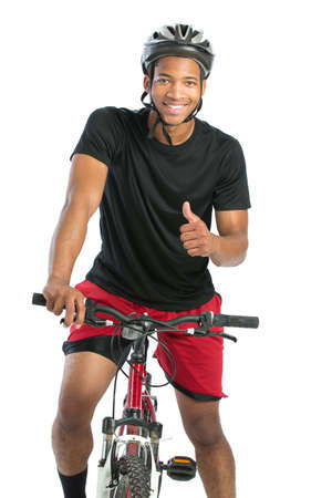 african american male: Cheerful Young African American Male Riding Bike Isolated on White Background Stock Photo