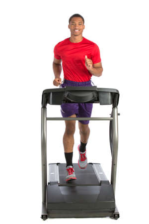 machine man: Healthy Young African American Running in Treadmill Isolated on White Background Stock Photo