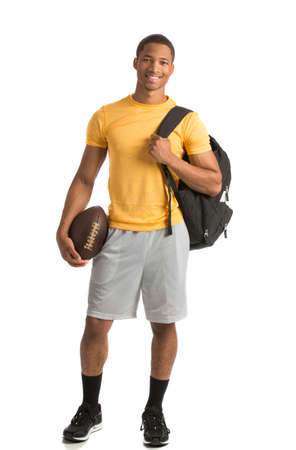 african american male: Happy African American College Student Holding Football on Isolated White Background
