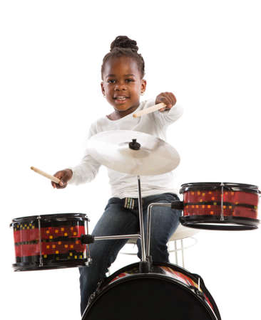 drummer: Four Year Old African American Girl Playing Drum Set Isolated on White Background Stock Photo