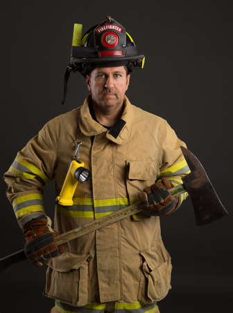 sholders: Serious looking confident firefighter Headshot Portrait on Dark Background