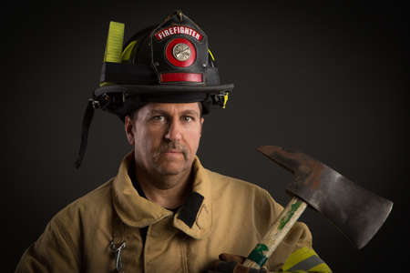 department head: Serious looking confident firefighter Headshot Portrait on Dark Background