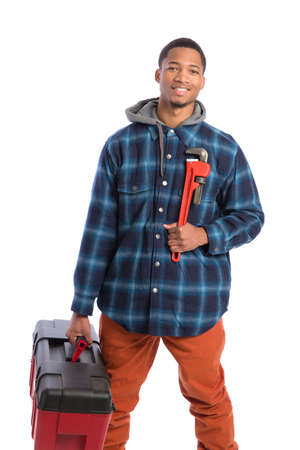 Smiling Young African American  Worker Holding Toolbox and Wrench Isolated on White Background photo
